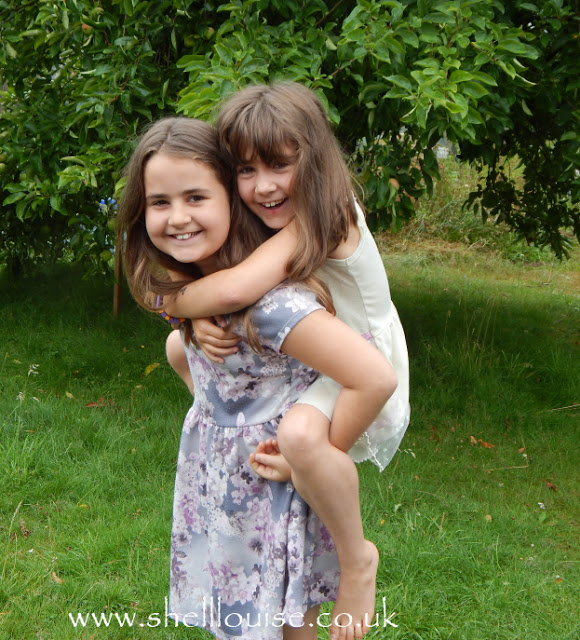 Photo challenge - transport - kayCee giving Ella a piggy back, transporting her around the garden!