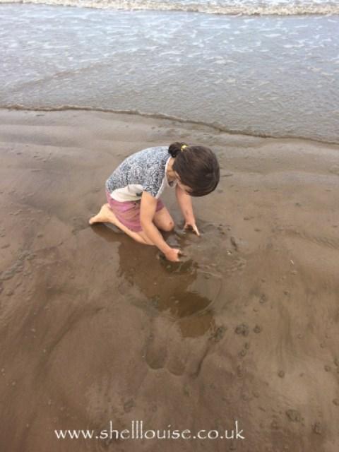 Ella looking for crabs