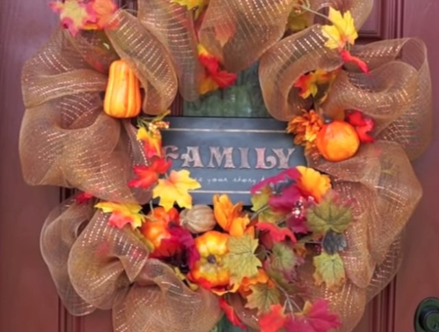 Autumn wreath and family plaque on a door
