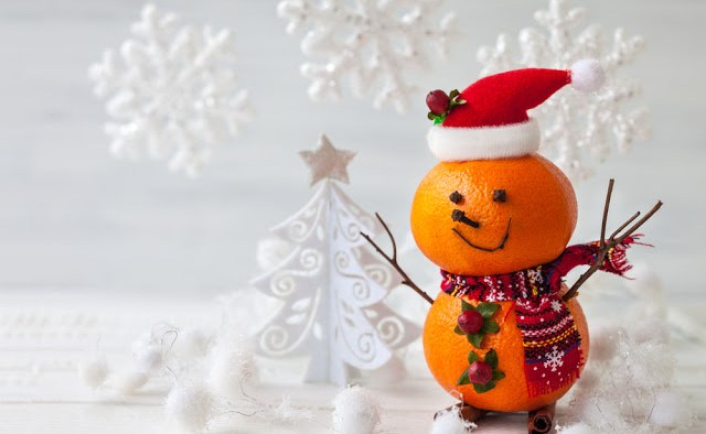 Snowman made from oranges