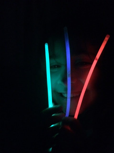 Ella holding glow sticks