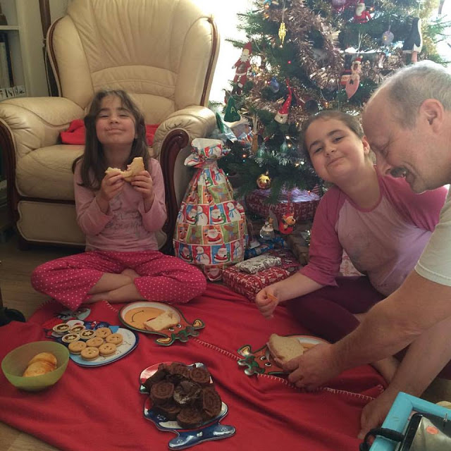 Kaycee, Ella and daddy having a picnic by the Christmas tree