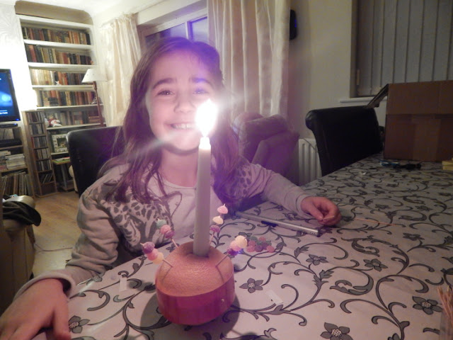 Ella's Christingle all lit
