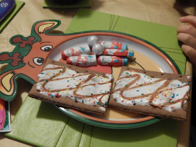 Pop tarts and Santa chocolates on a Rudolph plate
