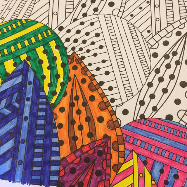 Close up of part coloured colouring book