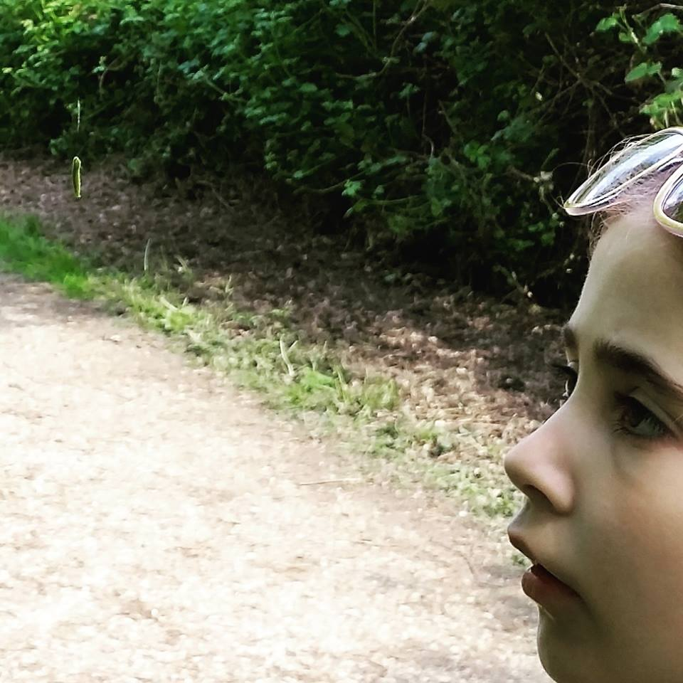Ella looking at a caterpillar at Whisby Nature Park