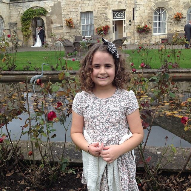 Kaycee at the wedding with curly hair