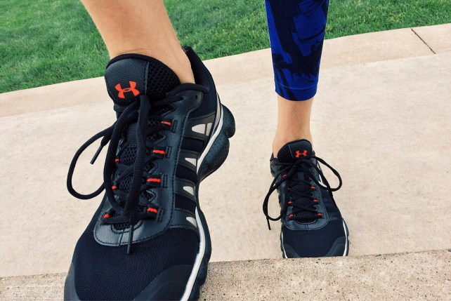Pair of feet with trainers on ankle pain best ankle braces