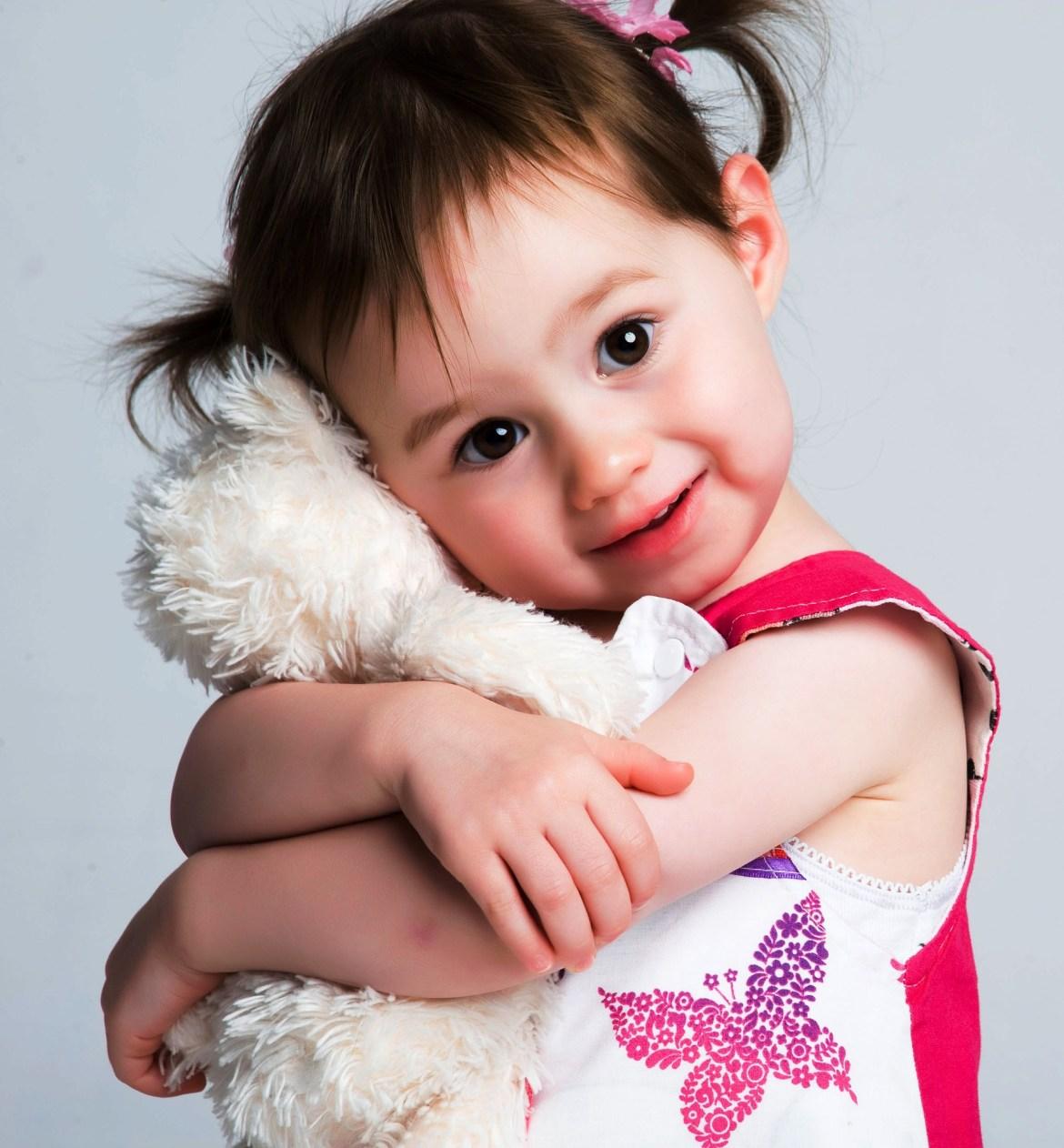little girl cuddling a teddy