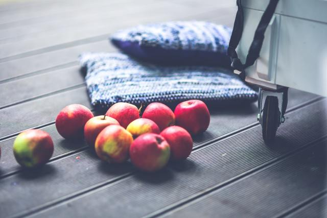 Apples on a table - revitalise your home for Autumn