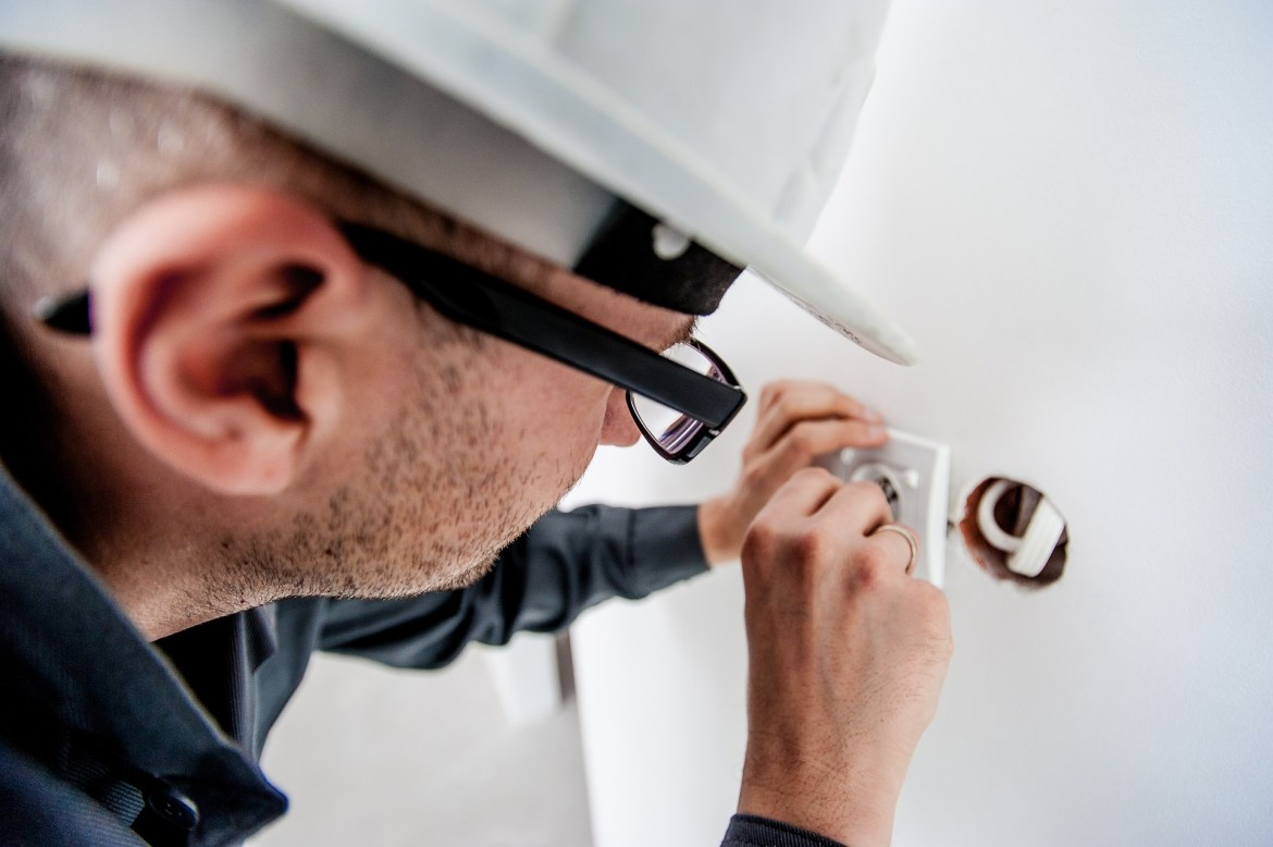 Electrician using electrical tools