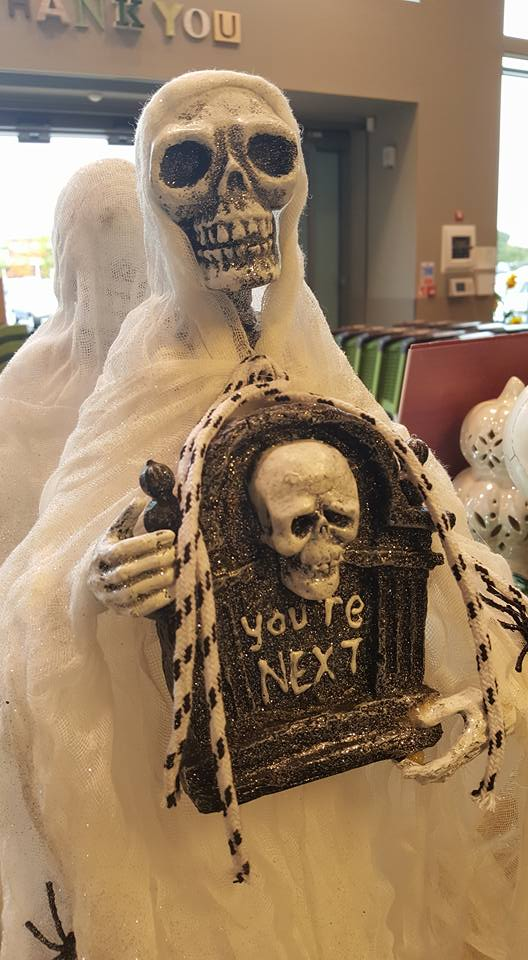 HomeSense Halloween - skeleton in a cape with a gravestone saying you're next