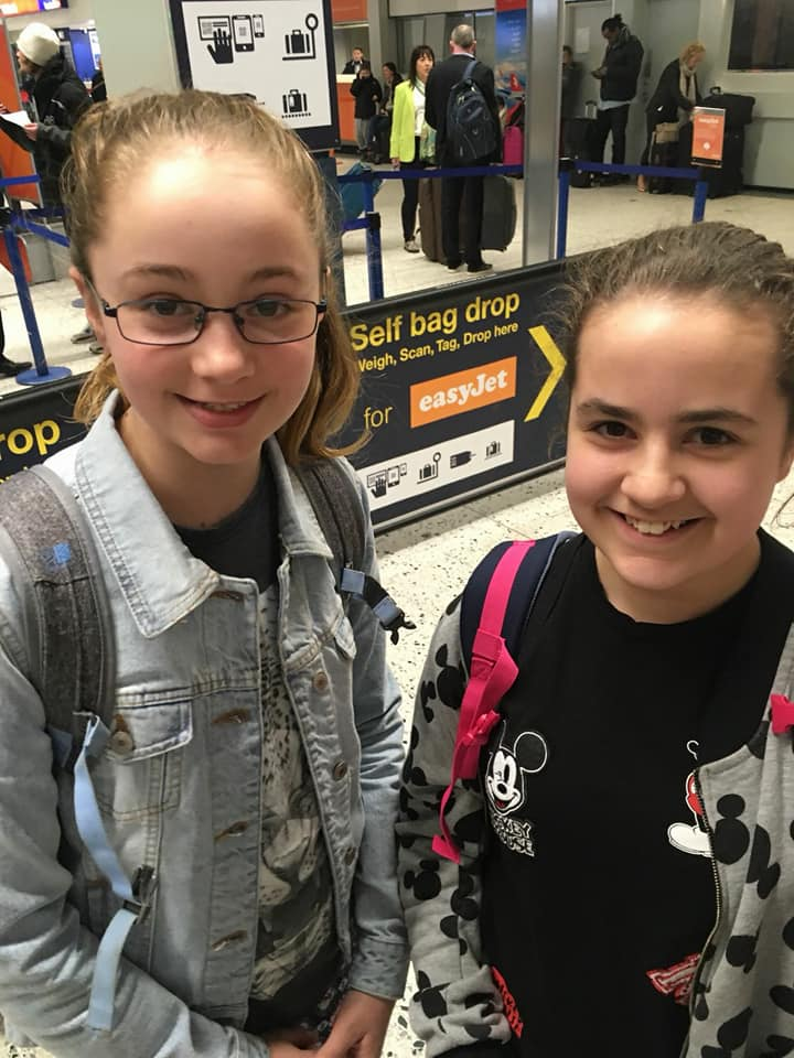 KayCee and Emma at the airport going to Greece