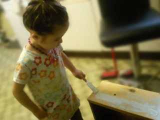 Ella helping to paint!