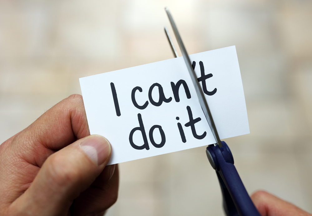 Combat negative thoughts - a note is being help in one hand that says I can't do it. The other hand is holding scissors and is going to cut off the T