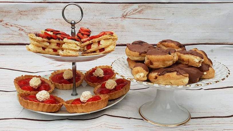 Patisserie week - mille feuille with strawberries and cream, strawberry tarts and chocolate chou buns and eclairs