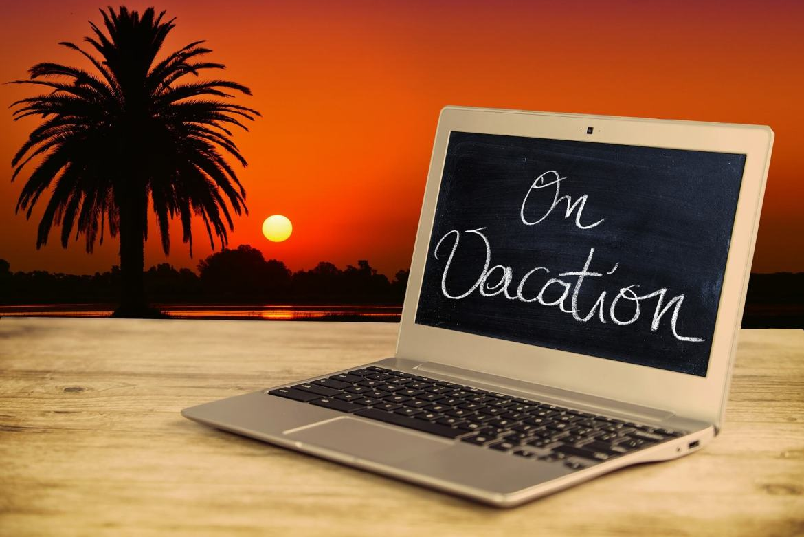 reax on holiday by taking a social media break - laptop with 'On vacation' written on the screen
