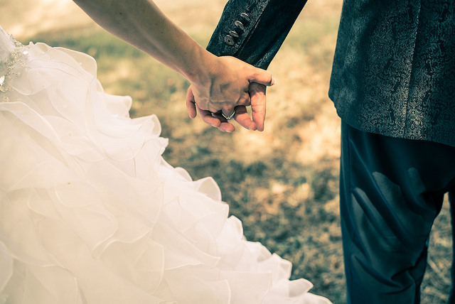 Wedding - bride and groom holding hands