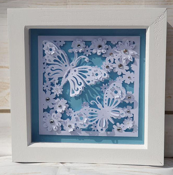 Butterfly paper sculpture box frame made with the Cricut maker