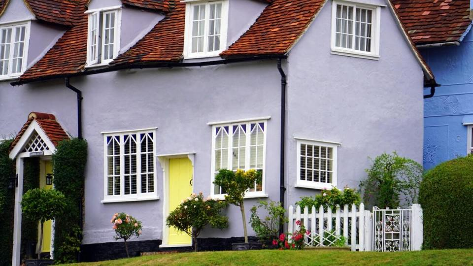 lilac house with yellow door - revamp your home