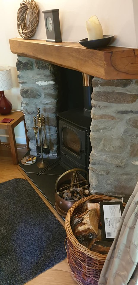 Log burning fireplace at Felin Fach cottage, Pumsaint, Wales