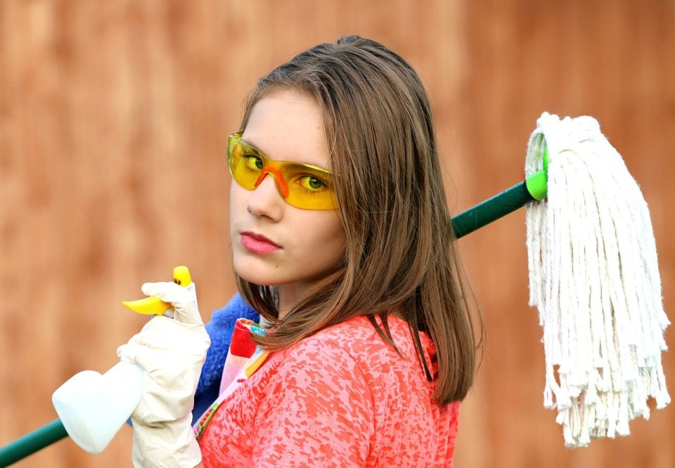 house cleaning woman with cleaning tools