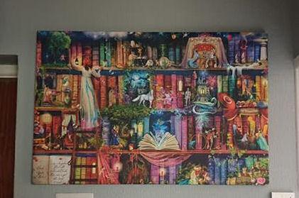 Photowall treasure hunt bookcase wall canvas