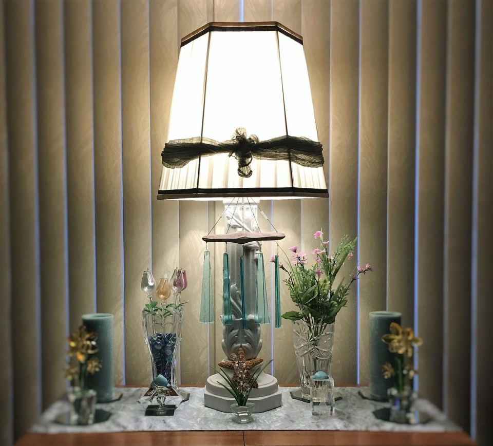 Home decor vases, candles and a lamp
