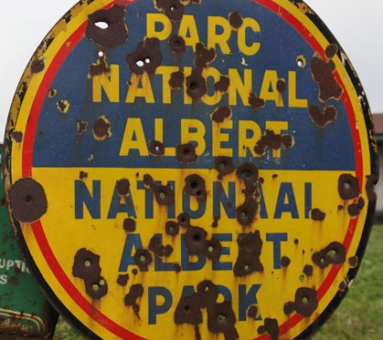 A park sign from colonial times. The bullet holes were made by Interahamwe rebels during the civil war in the 1990s.