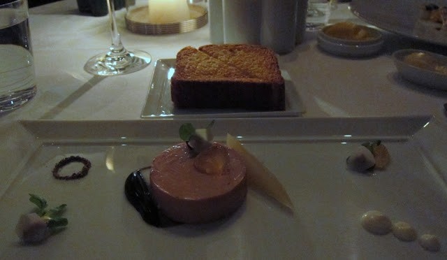 Torchon of Foie Gras ($40 Supplement) - White Wine Poached Pear, Candied Walnuts and Black Winter Truffle Purée