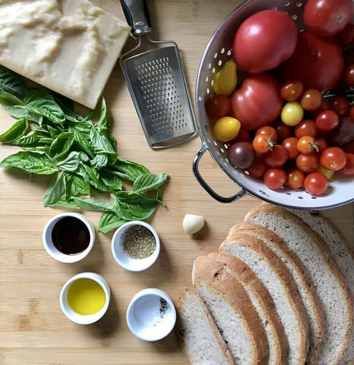 Some of the ingredients required to make Tomato Bruschetta include Italian rustic bread, garden fresh tomatoes and basil.