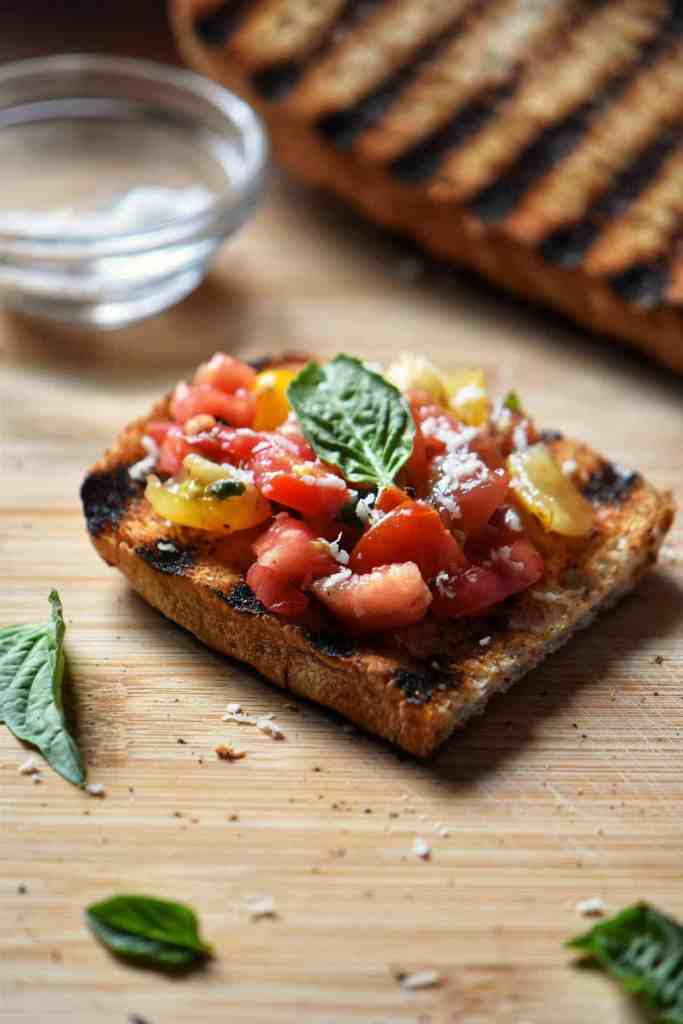 Charred Italian Crusty bread topped with a tomato basil mixture makes the best bruschetta.