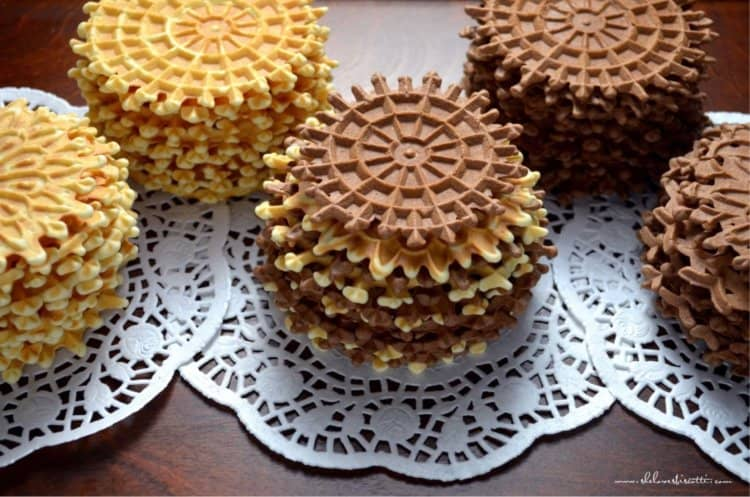 Several stacks of Pizzelle della Nonna are placed on a tray.