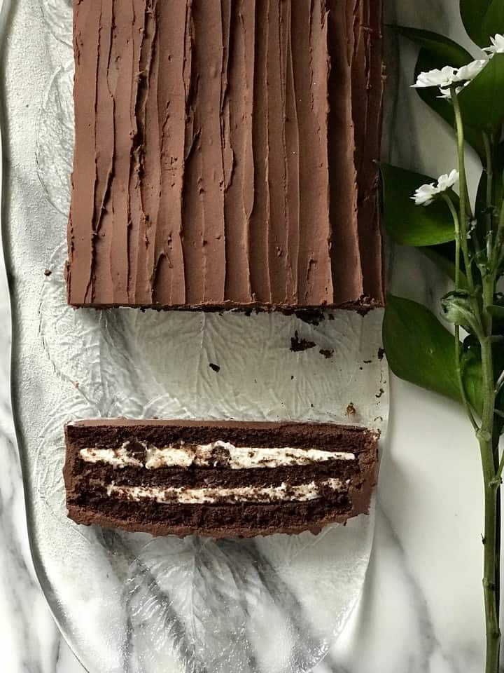 An overhead shot of a slice of chocolate cream cake.