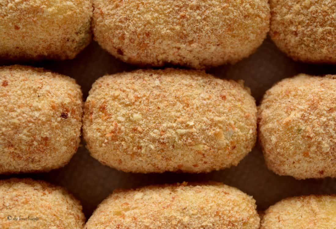 Croquettes are coated with the bread crumb mixture.