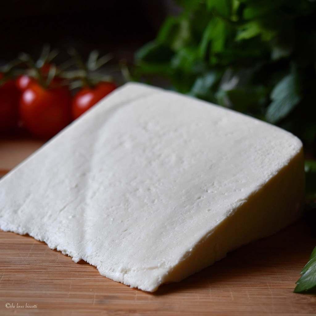 Wedge of the ricotta salata used to make the best Italian salad.