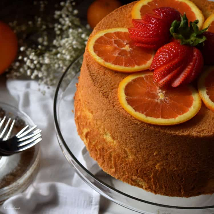 Stawberries and orange slices atop the Perfect Light Fluffy Orange Chiffon Cake.