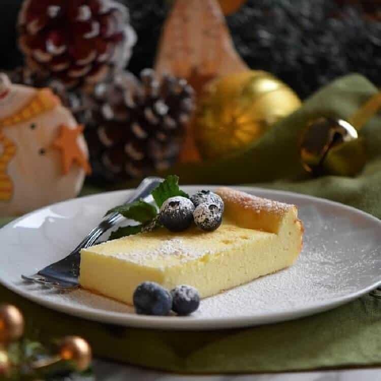 Ricotta cake on a cake platter.