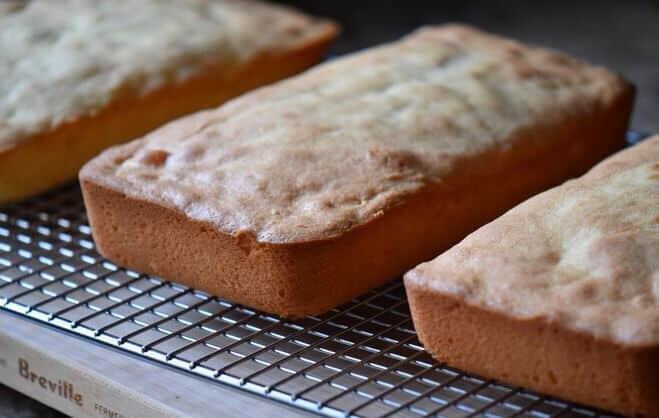 Three loaves of anise biscotti cooling off on a wire rack.