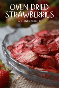 A close up of crispy looking oven dried strawberries in a glass bowl.