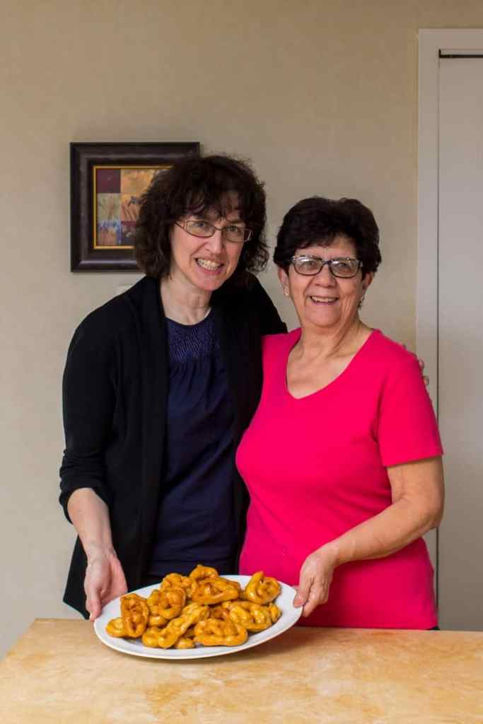 A picture of Maria (from She Loves Biscotti) with her friend Maria and a platter of freshly made Caragnoli.