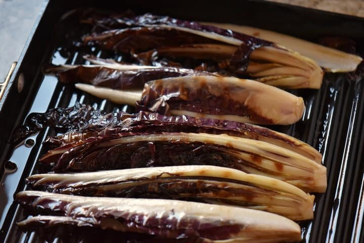 Radicchio sections in the process of being grilled.