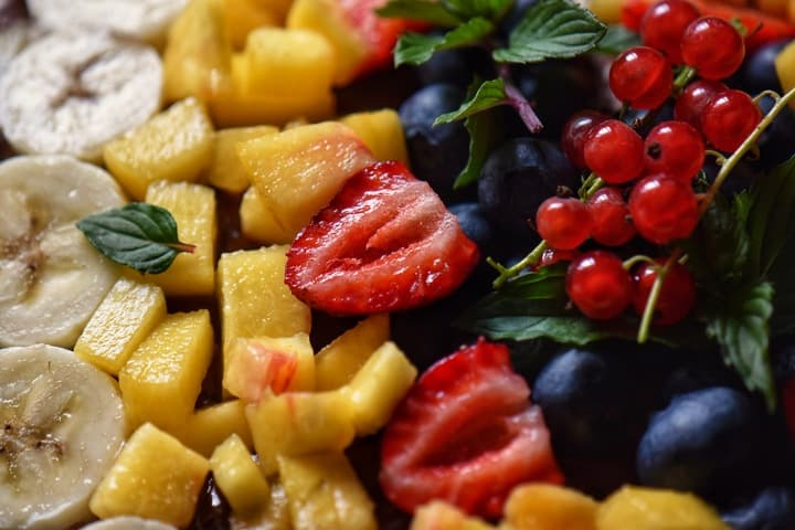 Sliced strawberries, diced fresh peaches and blueberries are some of the seasonal fruits used in this recipe.