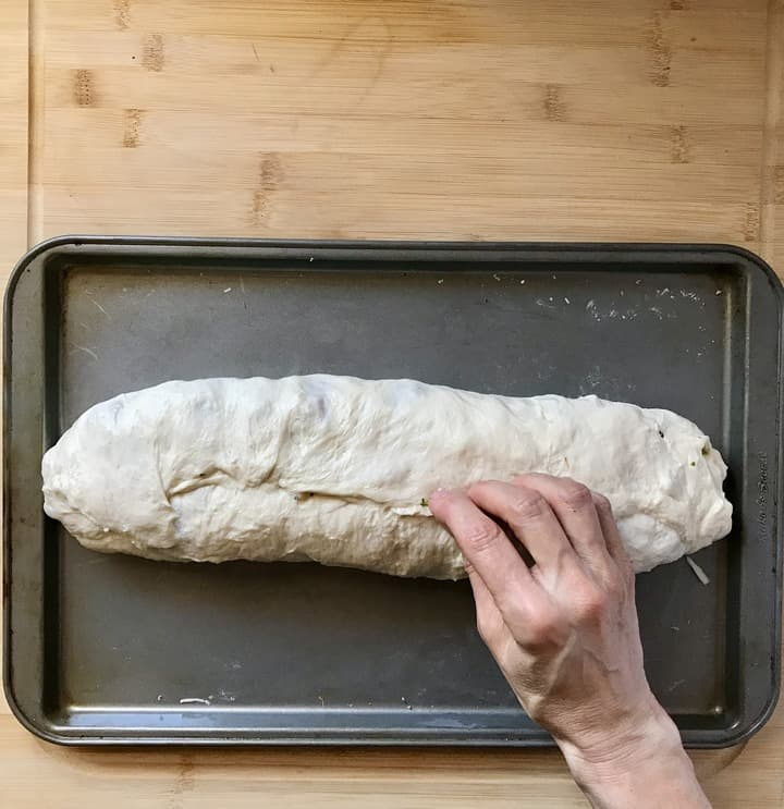 The pizza dough is rolled together just like a jelly roll.