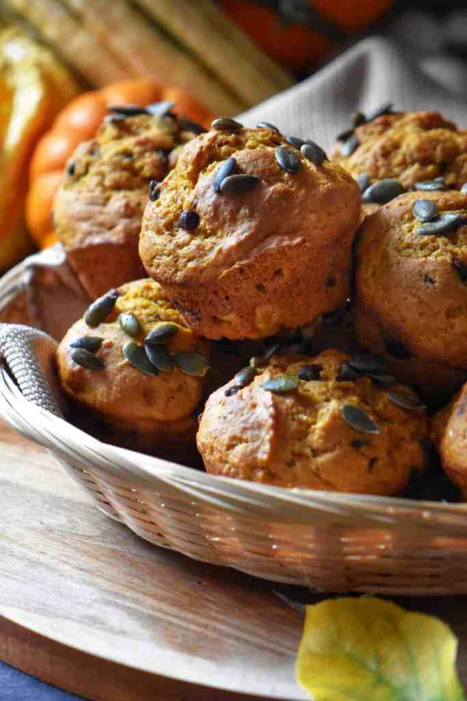 Pumpkin spice muffins in a wicker basket.