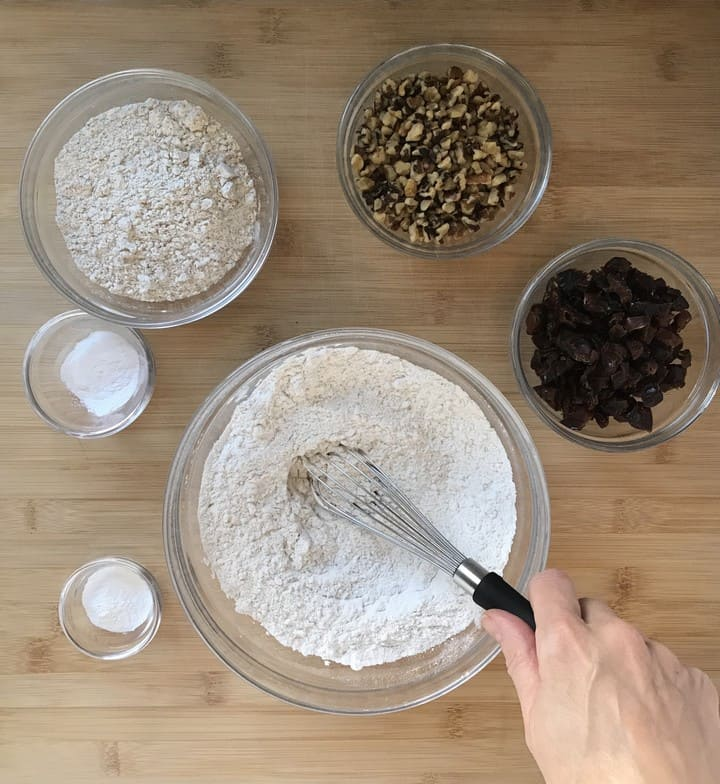 Ingredients to make crunchy oat cookies in individual bowls.