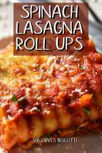 A close up of the cheesy topping of spinach lasgana roll ups.
