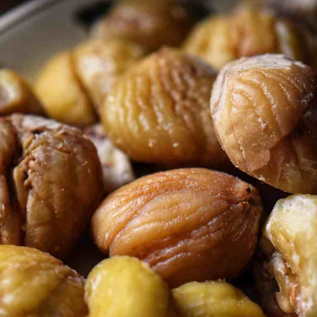 A close up photo of chestnuts without their shells.