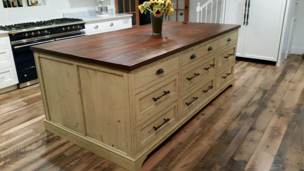 custom kitchen islands hgtv cabinets shenandoah home rustic farm tables a wooden island is often the heart of your it s place where vegetables are chopped stories shared and organizing for week ahead