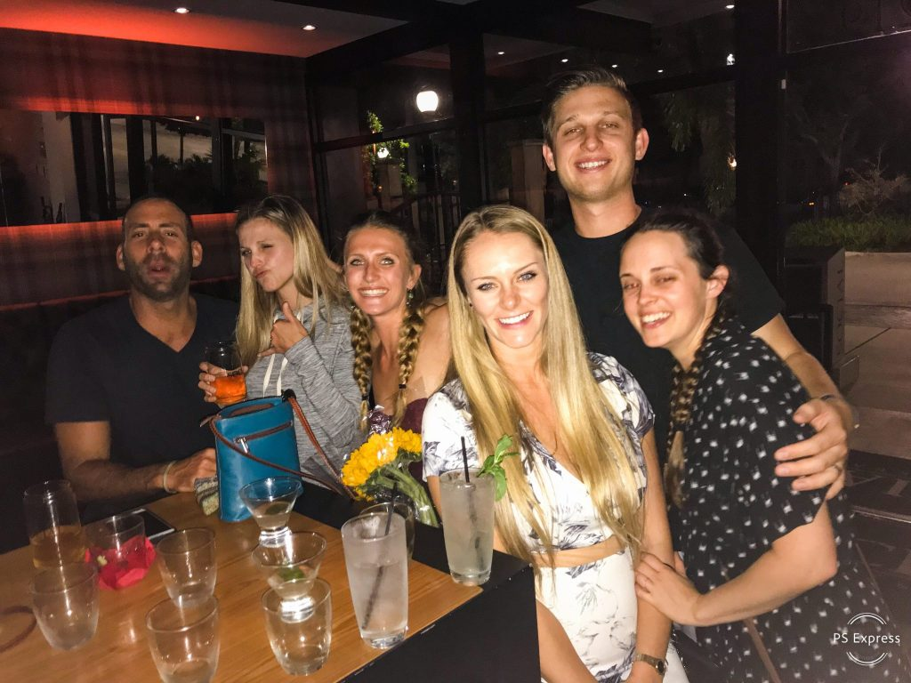 group-men-women-at-bar-smiling-drinks-table